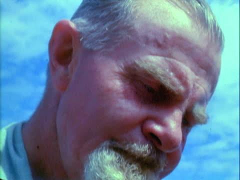 cu man holding bandicoot / australia - only mature men stock videos & royalty-free footage