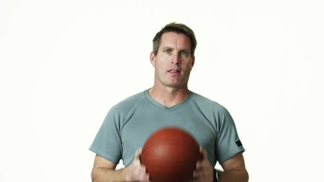 MS Man holding basketball, against white background / Orem, Utah, USA