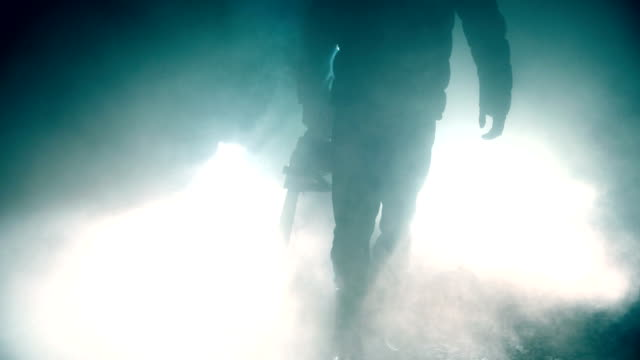 man holding chainsaw at night - chainsaw stock videos & royalty-free footage