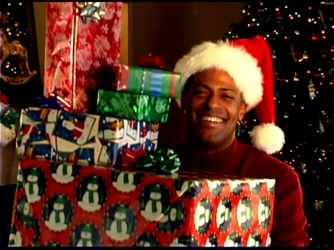man holding christmas presents - see other clips from this shoot 1407 stock videos and b-roll footage