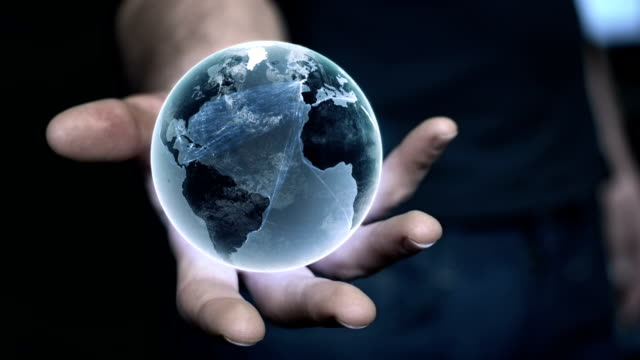 Man holding earth model in his hand. Global communications metaphor