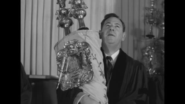 man holding elaborate torah starts to recite the first book of genesis and vo others join him / note exact year not known documentation incomplete - torah stock videos and b-roll footage