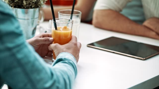 man holding glass of orange juice - straw stock videos & royalty-free footage