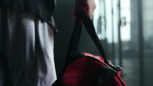 man holding gym bag coming to treining - gym stock videos & royalty-free footage