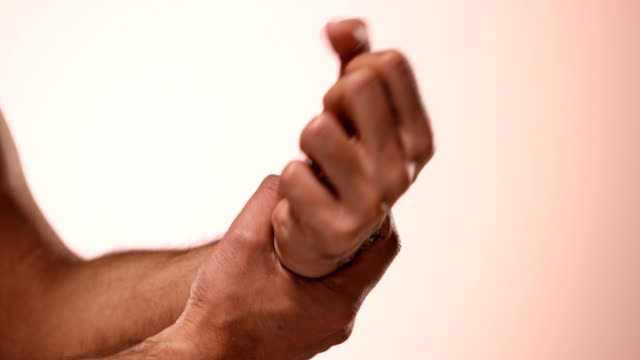 cu man holding his painful wrist and rotating / new delhi, delhi, india - wrist stock videos & royalty-free footage