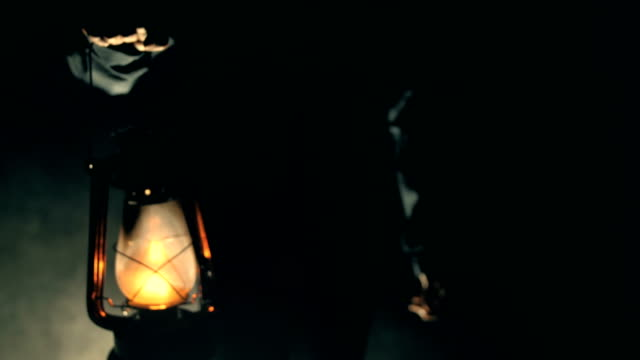man holding kerosene lamp in dark night - electric lamp stock videos & royalty-free footage
