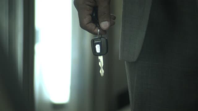 cu man holding key / new york city, new york, usa - only mature men stock videos & royalty-free footage