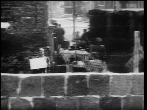 man holding mirror reflecting sunlight into camera on east side of berlin wall - 1961 stock videos & royalty-free footage
