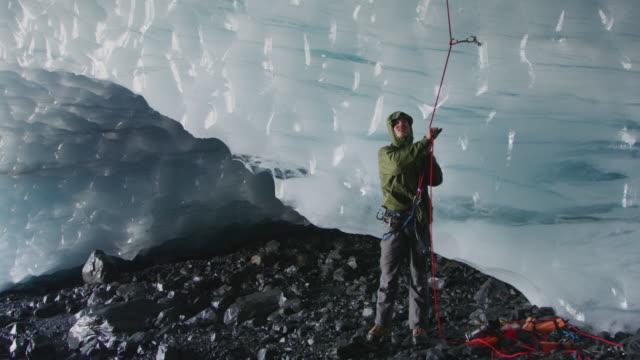 man holding rope belaying on glacier / palmer, alaska, united states - belaying stock videos & royalty-free footage