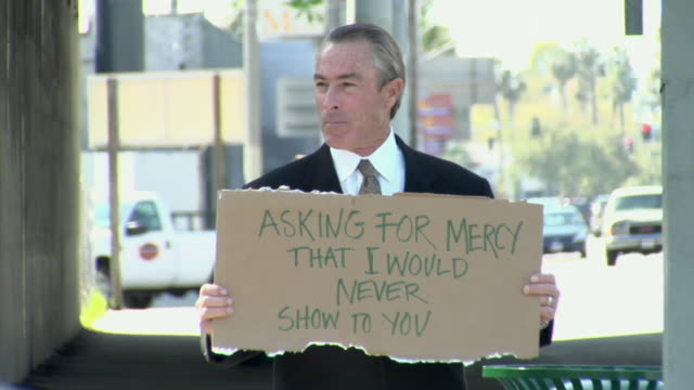 ms man holding sign saying 'asking for mercy that i would never show to you', los angeles, california, usa - see other clips from this shoot 1458 stock videos and b-roll footage
