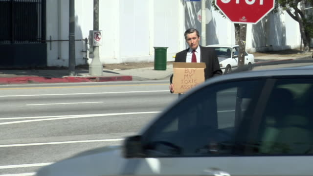 ws man holding sign saying 'buy my toxic assets' on street, los angeles, california, usa - see other clips from this shoot 1458 stock videos and b-roll footage