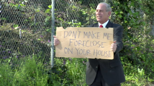 ms man holding sign saying 'don't make me foreclose on your house' on street, los angeles, california, usa - see other clips from this shoot 1458 stock videos and b-roll footage
