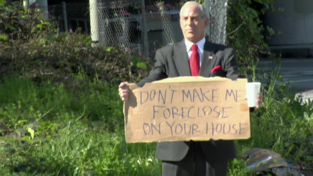 ms zi zo man holding sign saying 'don't make me foreclose on your house' on street, los angeles, california, usa - satire stock videos & royalty-free footage