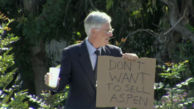 ms man holding sign saying 'don't want to sell aspen' on street, los angeles, california, usa - see other clips from this shoot 1458 stock videos and b-roll footage