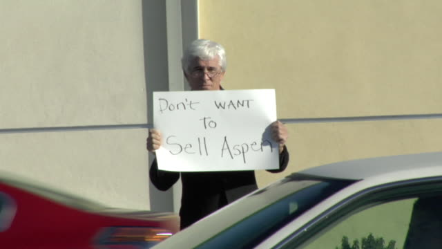 ms shaky man holding sign saying 'don't want to sell aspen' on street, los angeles, california, usa - see other clips from this shoot 1458 stock videos and b-roll footage
