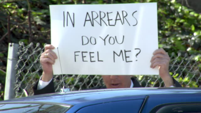 cu man holding sign saying ''in arrears do you feel me?' in front of face, talking to person in car, los angeles, california, usa - see other clips from this shoot 1458 stock videos and b-roll footage