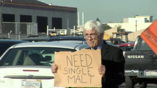 ms shaky man holding sign saying 'need single malt' on busy street, los angeles, california, usa - see other clips from this shoot 1458 stock videos and b-roll footage