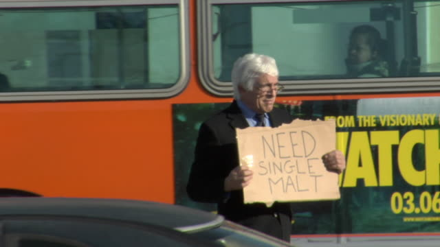 ms shaky pan man holding sign saying 'need single malt' on busy street, los angeles, california, usa - see other clips from this shoot 1458 stock videos and b-roll footage