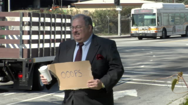 ms shaky man holding sign saying 'oooops' on busy street, los angeles, california, usa - see other clips from this shoot 1458 stock videos and b-roll footage