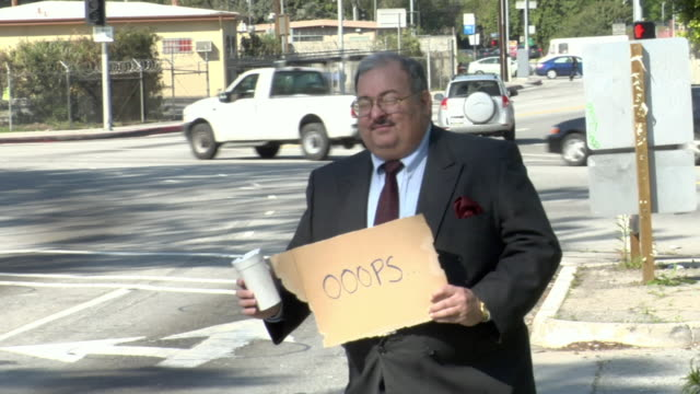 ms man holding sign saying 'oooops' on busy street, los angeles, california, usa - see other clips from this shoot 1458 stock videos and b-roll footage