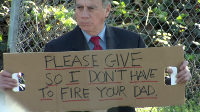 zi cu man holding sign saying 'please give so i don't have to fire your dad' on street, los angeles, california, usa - see other clips from this shoot 1458 stock videos and b-roll footage