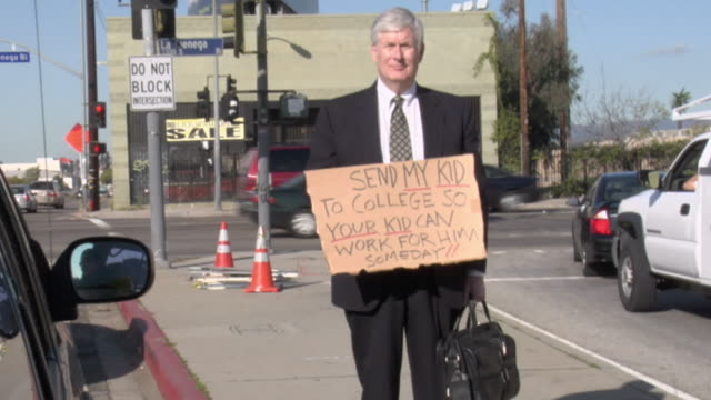 ms shaky man holding sign saying 'send my kid to college so your kid can work for him someday' on street, view from car, los angeles, california, usa - see other clips from this shoot 1458 stock videos and b-roll footage
