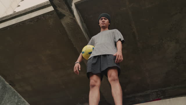 man holding soccer ball - motivation stock videos & royalty-free footage