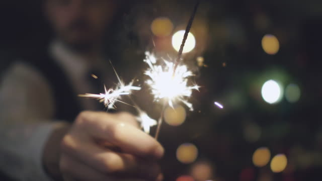 man holding sparkler at christmas - celebration event stock videos & royalty-free footage