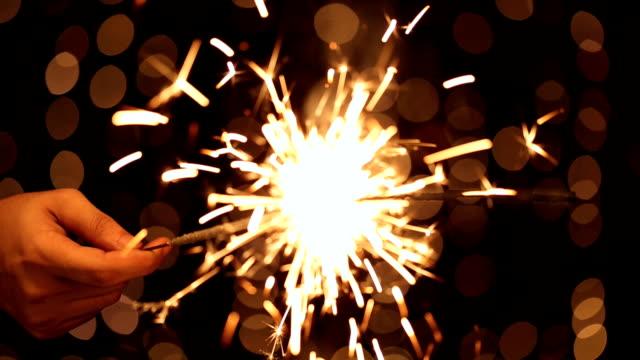 cu man holding sparkler during diwali festival - 部分点の映像素材/bロール