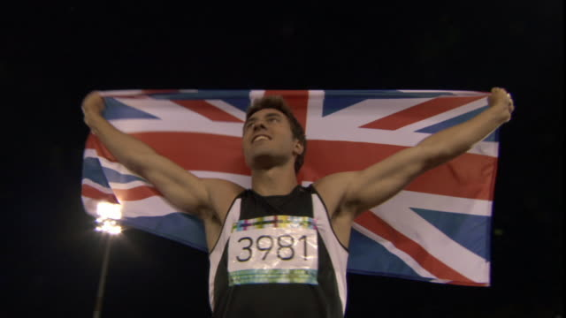 LA MS Man holding up British flag after winning track and field event/ Sheffield, England