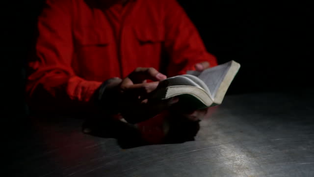 man holds a bible and handcuffs - prisoner stock videos & royalty-free footage