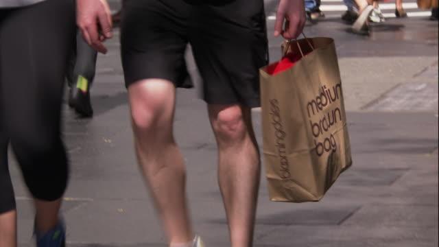 a man holds a bloomingdale's brown bag - bloomingdales stock videos & royalty-free footage