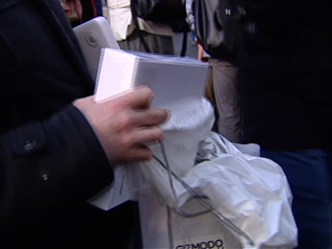 man holds a brand new ipad in it's box outside of the apple store in new york city, the day of it's launch. - digital tablet stock videos & royalty-free footage
