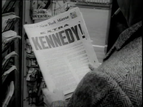 a man holds a newspaper bearing the headline kennedy - election stock videos & royalty-free footage