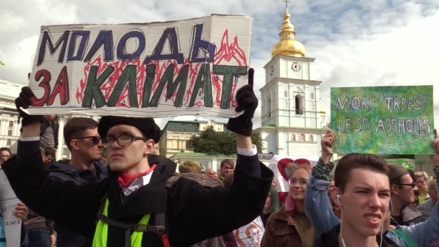 man holds a poster 'youth for climate' during the 'global climate strike' climate change action protest in kiev, ukraine, on 20 september, 2019.... - strike protest action stock videos & royalty-free footage