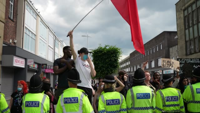 a man holds a red flag as he protests during an antiracism demonstration on june 13 2020 in bolton england a number of antiracism protesters have... - rassismus stock-videos und b-roll-filmmaterial