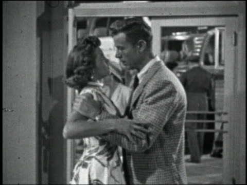 b/w 1956 man holds woman by shoulders, she shrugs him off + slaps him in face in bus station - boyfriend stock videos & royalty-free footage