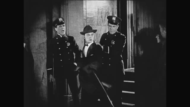 1920 man (buster keaton) hopes to be arrested in casino bust, but is passed over - anno 1920 video stock e b–roll