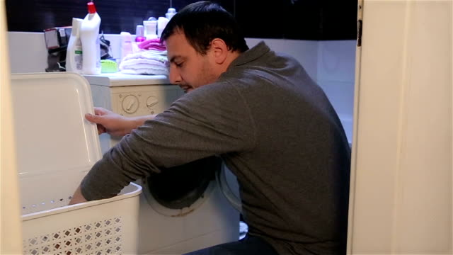 man housewife - washing machine stock videos and b-roll footage