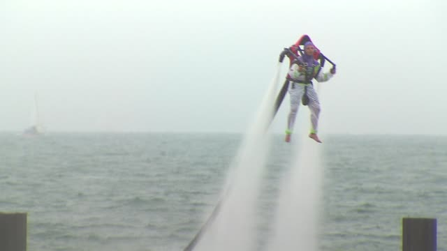 man hovers over water with water jet pack on august 17, 2014 in chicago, illinois. - chicago air and water show stock videos & royalty-free footage