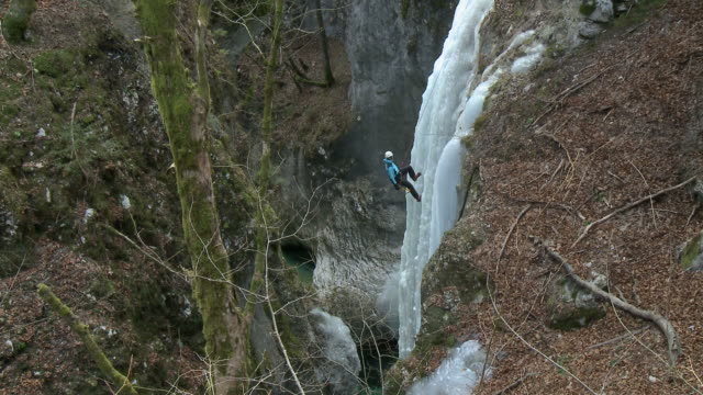 hd: man ice climber - abseiling stock videos & royalty-free footage