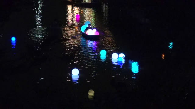 man in a boat with lanterns - floating on water stock videos & royalty-free footage