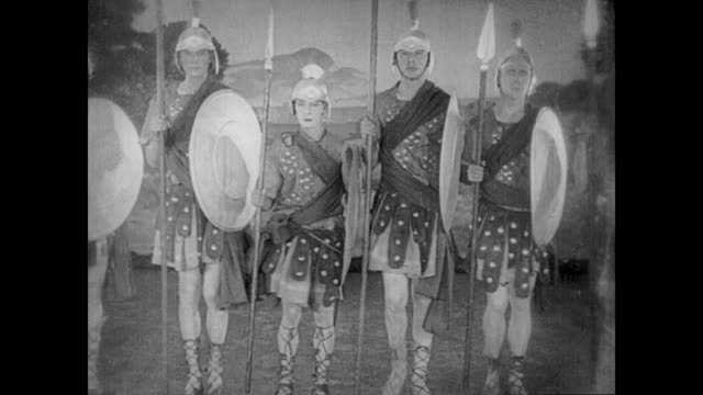 stockvideo's en b-roll-footage met 1922 man (buster keaton), in a chorus of gladiators, has trouble keeping with the beat, upsetting the production's star and director - actrice