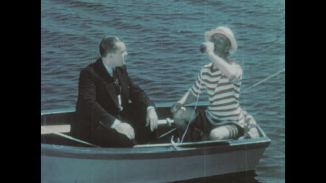 1930 A man in a rowboat knocks down another drink