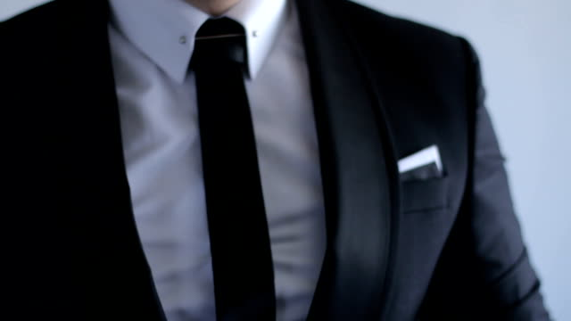 man in a suit correcting his tie - dj stock videos & royalty-free footage