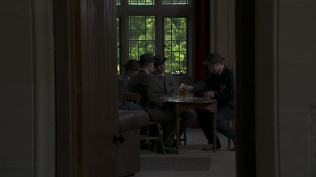 man enters room, sits at table with other men - nazi-era historic reenactment - holocaust stock videos & royalty-free footage