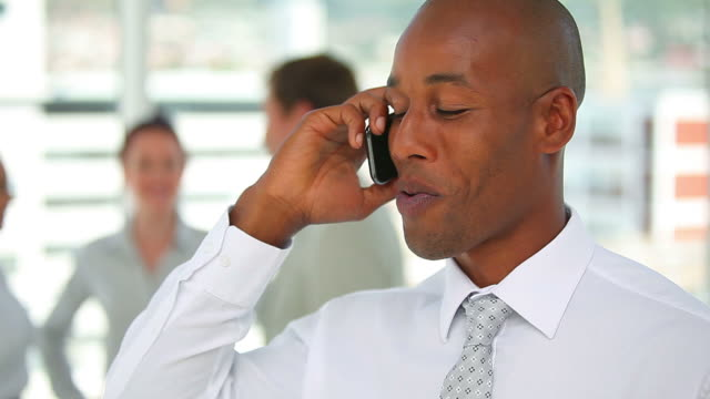 Man in a suit talking on the phone