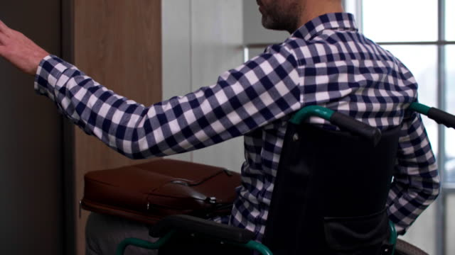 man in a wheelchair/debica/poland - wheelchair stock videos & royalty-free footage