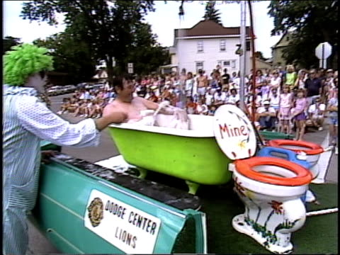 man in bathtub on parade float - parade float stock videos and b-roll footage