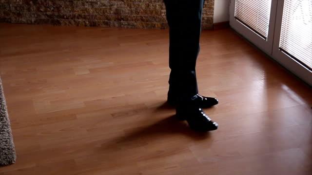 Man in black shoes walking